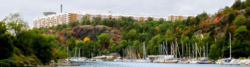 Skogen Trolldalen idag med båtklubbar nedanför